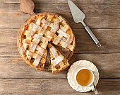 Composition with delicious apple pie on wooden background