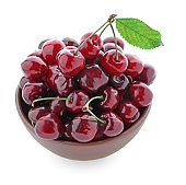 Bowl with ripe cherry on white background