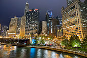 Chicago Illinois city riverwalk and river at night