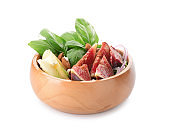 Bowl with delicious fig salad on white background