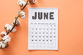 Calendar page of June on color background