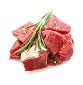 Pieces of raw meat with spices on white background
