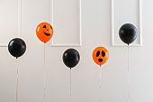 Color balloons for Halloween party on light background