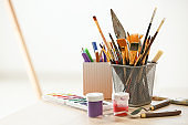 Tools and paints of professional artist on table