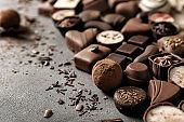 Yummy chocolate candies on grey background