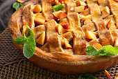 Tasty homemade peach pie on table, closeup