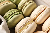 Tasty colorful macaroons in box, closeup