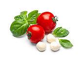 Delicious tomatoes, mozzarella cheese and fresh basil on white background