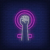 Clenched hand and female symbol neon sign