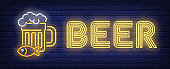 Beer neon sign. Beer mug with snack