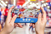 Hand hold mobile phone and using augmented reality ( AR ) app for see promotion sale in supermarket store,Digital lifestyle Technology concept