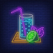Lemonade glass with straw and lime neon sign
