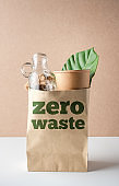 zero waste  and plastic free concept. grocery bag with glass bottle ,paper cup and leaf on white table.eco friendly