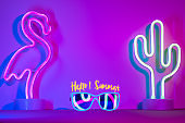Hello summer with flamingo,cactus,sunglasses refection neon pink and blue and green light on table with copy space.Trendy vacation holiday background.