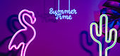 Summer time with pink flamingo, cactus and monstera leaf with neon pink and blue light.Vacation banner mock up space for adding text.