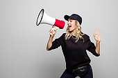 Woman in street outfit singing into megaphone