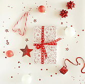 Christmas background with gift boxes,  Xmas or new year decorations pattern on white background top view