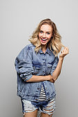 Cheerful young woman wearing denim jacket