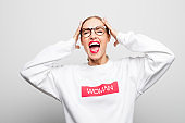 Portrait of shocked woman in white t-shirt stock photo