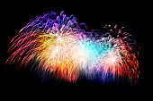 rainbow firework displays  for celebration happy new year and merry christmas on night sky background, fireworks new year