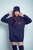 Sensual asian young woman in black hooded shirt