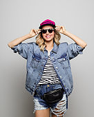 Smiling woman wearing sunglasses and denim jacket