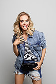 Portrait of cheerful woman wearing denim jacket