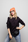 Beautiful woman wearing nerd glasses and knit hat