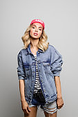 Portrait of trendy woman wearing denim jacket