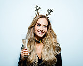 Christmas portrait of beautiful woman with a glass of champagne, close up of face stock photo