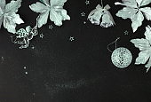 Christmas background. Xmas or new year white silver color decorations on black  background with empty copy space for text.  holiday and celebration concept for postcard or invitation. top view