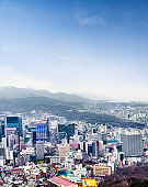 Seoul cityscapes, skyline, high rise office buildings and skyscrapers in Seoul city, winter daylight, top view in winter, Seoul, Republic of Korea, in mist winter season
