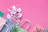 Orchid flowers on geometric background with copy-space, foral paper background in pink