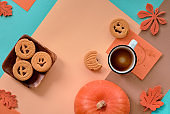 Halloween cookies and emppty coffee up, flat lay geometric background