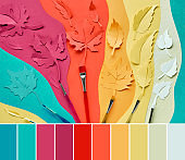 Color matching palette from image of various paper Autumn leaves and paintbrushes