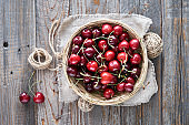 Tasty cherry, flat lay on rustic wooden boards