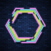 Neon sign on brick wall