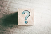 Question Mark On A Wooden Block On A Table