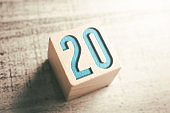 Number 20 On A Wooden Block On A Table