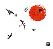 Flying swallow birds and big red sun on white background. Traditional Japanese ink wash painting sumi-e. Hieroglyph - joy
