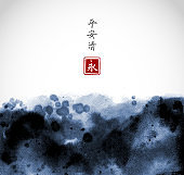 Abstract blue ink wash painting on white background. Traditional Japanese ink wash painting sumi-e. Hieroglyphs - peace, tranquility, clarity, eternity