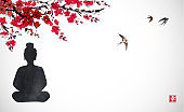 Silhouette of Buddha sitting under the sakura blossom and birds flying in the sky. Traditional oriental ink painting sumi-e, u-sin, go-hua. Hieroglyph - happiiness