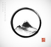 Ink wash painting with mountains in black enso zen circle on white background. Traditional oriental ink painting sumi-e, u-sin, go-hua. Hieroglyph - beauty