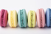 Colorful macarons on white background.