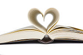 Open book with heart shaped pages. Love for reading