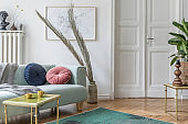 Stylish scandinavian living room and dining room with design mint sofa, mock up poster map, furniture, plants and elegant personal accessories. Modern home decor. Open space. Template. Ready to use.