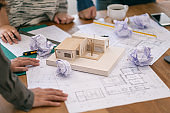 an architect feel stressed after working on architecture model together