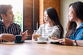 people enjoyed talking, reading and drinking coffee together in cafe