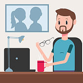 Businessman with a laptop and a cup of coffee working behind an office desk. Vector cartoon character of a bearded man isolated on background.