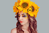 woman model with yellow sunflowers head floral headband eyes closed looking down
